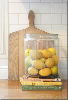 Pretty kitchen vignette: lemons, cookbooks and a cutting board. (Cool Kitchen Accessories)