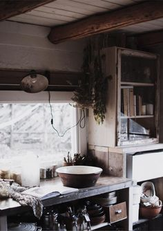 my scandinavian home: A Magical Norwegian Cottage With a Wabi Sabi Vibe Neutral Kitchen, Eclectic Kitchen, Rustic Kitchen, Vintage Kitchen, Sheepskin Throw, Magical Home, Porcelain Sink, Vintage Mirrors, String Lights Outdoor