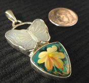 Love this mother of pearl carved butterfly pendant! The designer, Anna King, has combined it with a handpainted mother of pearl piece.   #MotherofPearl #Handpainted #Pendant #Handmade #Jewelry #IowaCity