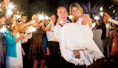 The bride and groom exited their reception surrounded by sparklers.