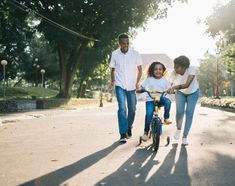 Man Standing Beside His Wife Teaching Their Child How To Ride Bicycle Picture. Man Standing Beside His Wife Teaching Their Child How to Ride Bicycle. Family Photography, Photography Tips, People Photography, Portrait Photography, Adoption, Man Standing, Working Moms, Family Activities, Family Games