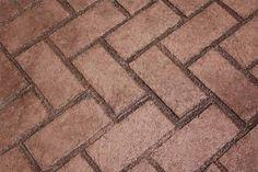 red brick stamped concrete driveway - Google Search - love the herringbone design.