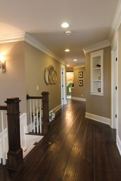 Hard wood, white trim, taupe walls