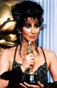 Cher and her Academy Award for Moonstruck, 1988.