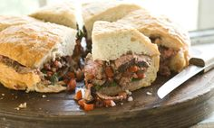 One sandwich to serve six mouths—this is grilled flank fare at its very best.