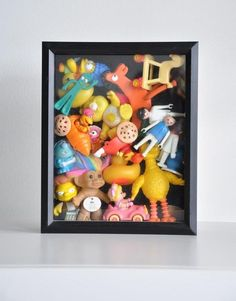 Can't bear to part with your child's old toys? Keep them out of the way (and on display) in a shadow box. Can't bear to part with your child's old toys? Keep them out of the way (and on display) in a shadow box. Diy And Crafts, Crafts For Kids, Toy Display, Displaying Collections, Old Toys, Children's Toys, Baby Toys, Shadow Box, Vintage Toys