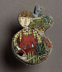 Polymer clay micromosaic brooch by Cynthia Toops; metalwork by Chuck Domitrovich.