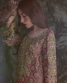 A masterpiece to behold! This super stunning deep pink Lame shirt is heavily worked with Zardoze embroidery on the neckline and hemline is… Shadi Dresses, Pakistani Formal Dresses, Pakistani Party Wear, Pakistani Wedding Outfits, Pakistani Couture, Pakistani Dress Design, Indian Outfits, Rose Shirts, Mehndi Dress