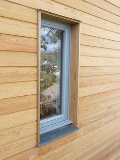 Window in larch clad wall:
