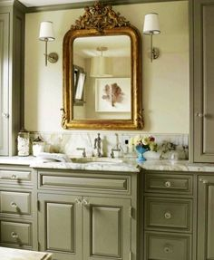 LOVE this green bathroom cabinet