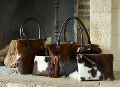 This luxurious cowhide weekend bag is lightweight, stylish and spacious enough to pack all your favourite outfits and accessories. Crafted from the very finest cowhide, each bag is unique, thanks to the hand-selected hide and one-of-a-kind patterning. Cowhide Purse, Cowhide Leather, Boutique Accessoires, Oversized Clutch, Alpaca, Cow Hide, Weekender, Duffel Bag, Leather Handle