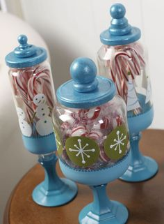 Create apothecary jars to hold holiday candy using dollar store supplies! This Christmas craft is easy and budget friendly.