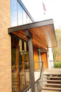 Christianson Construction designed and built this custom window wall for a local fraternity. Sustainable Building Materials, Porch Posts, Porch Area, Post And Beam, Custom Windows, Construction Design, Window Wall, Exterior Doors, Metal Roof