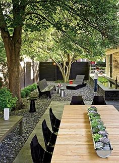 The DeGraces refaced the concrete patio in the courtyard with slate pavers and filled in the rest of the yard with complementary crushed stone. Chip made the table's centerpiece from a section of gutter.