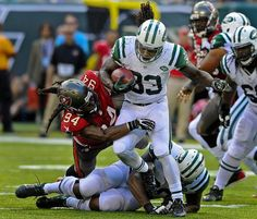 New York Jets running back Chris Ivory is tackled by Tampa Bay Buccaneers defensive end Adrian Clayborn in East Rutherford, N.J. (Bill Kostroun/AP)