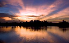 Christopher Michael - Sunset on the shores of the Sepik River, Papua New Guinea.