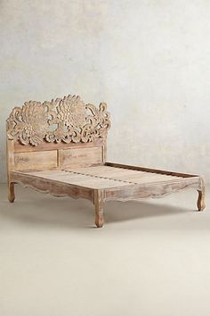 Handcarved Lotus Bed - anthropologie.com - a bed for the upstairs master? i think this bed is awesome. Dan likes it too.