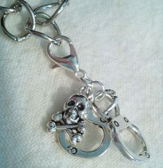 Handcuff Skull  Clip Charm Zipper Pull Great For Handbags Bracelets Necklaces by PersnicketyPatty on Etsy