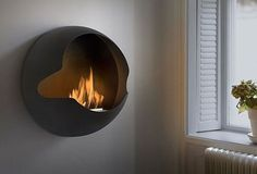 Chimney-free bio-fueled fireplaces.  Totally mobile and can be moved anywhere in the house.  Neat-o.