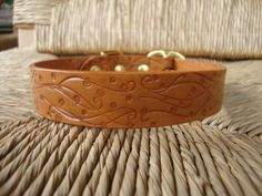 Blond Wheat Leather Dog Collar. Embossed Flowering Vine Design with Solid Brass Buckle.. $36.00, via Etsy.