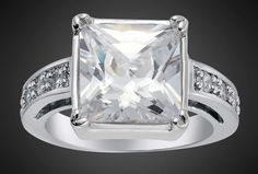 'WHITE TOPAZ 18K GP PRINCESS RING SIZE 8' is going up for auction at 12pm Wed, Aug 1 with a starting bid of $10.