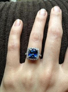 Sapphire engagement ring. I Love the idea of a stone with color instead of the traditional diamond!