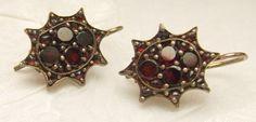 Victorian garnet earrings -    Star shaped earrings set with flat cut and rose cut garnets.  The setting is a low karat rose gold