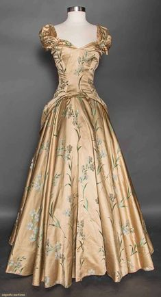 GOLD BROCADE EVENING GOWN, 1940s Gold silk satin w/ white carnation & green foliage brocade, 2 panels attach to halter bodice & tie at BW, voluminous circle skirt