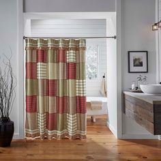 Prairie Winds shower curtain. An Americana Farmhouse inspired shower curtain for the bath.. Featuring various patchwork blocks in brick red, sage,and khaki in a simple layout.