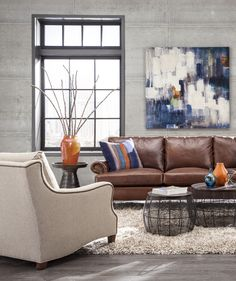 Here on the Huntington House 2100-20 Classic Sofa, we chose leather to accentuate its rustic appeal and balanced it with a colorful bohemian-gypsy inspired printed velvet on the throw pillows #furniture #leather