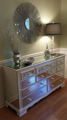 This specific mirrored dresser has already SOLD; however, we would love to make you a custom piece similar to the one pictured and it will take approximately 4 to 6 weeks to complete. We can find a furniture piece very similar to refinish and you can customize this piece to your color specifications and choose from our selection of hardware choices. Please convo us for more details. This elegant 9 drawer dresser has been refinished to showcase 14 custom cut mirrors with custom designed…