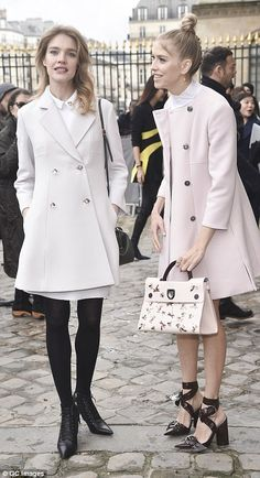 Off-duty: SupermodelsNatalia Vodianova and Elena Perminova share a joke in the Louvre's opulent forecourt ahead of the show