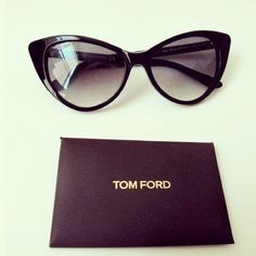 Tom Ford glasses please - love cat eye glasses very 50s let me get a head scarf x x