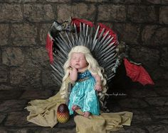 Our favorite Game of Throne baby photo so far. Baby Daenerys or if you prefer Khaleesi on the iron throne. Concept and design by Shannon Leigh Studios of Atlanta, GA. Check out more of her work as she is the 'Queen' of themed photo shoots.