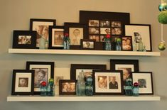 Shelves with many different sized picture frames...cute!
