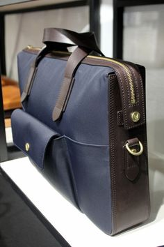 Mismo Bags  -  I like how the horizontal line continues and the panel layout of the leather and other textile.