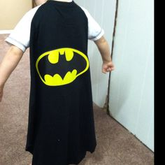 No-sew under 5 bucks cape! Simply take an old t-shirt and leave the collar intact and cut out the desired shape from the back side of the shirt. At Walmart they have iron ons for 2-3 dollars! You can either cut the collar and Velcro for fit or leave it together. So easy and fun!