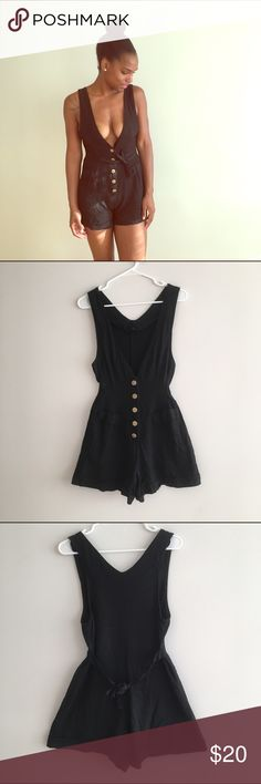 Romper Cute black romper with gold buttons. Tie in the back. Unknown brand. Pants Jumpsuits & Rompers