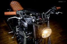Sexy leather work, and love that lamp grill. Bonneville T100 by Maccomotors