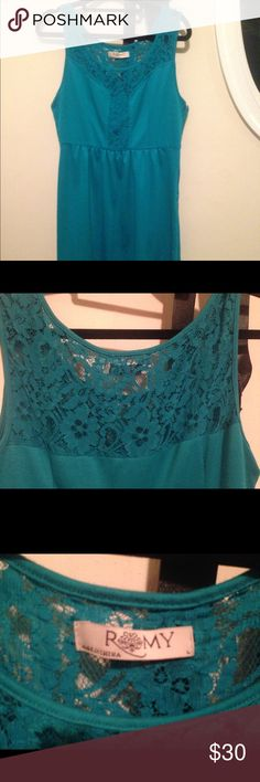 Dress from Francesca's. Size large. I've lost weight so it no longer hugs the curves! It's a pretty ocean like blue with lace in the front and the back, zipper down the side. Francesca's Collections Dresses Midi