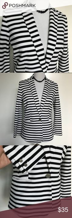 """🌿Banana Republic black/white Tall Blazer Beautiful, in excellent, like new condition, black and white stripe blazer. •Size 6 Tall.  Slit pocket, 2 brushed metal buttons on each sleeve and larger button closure. Soft, stretch knit. 89% rayon, 9% nylon,  2% spandex.   •18""""armpit to pit.   •15"""" Shoulders.   •22"""" Sleeve      •25"""" Length. Banana Republic Jackets & Coats Blazers"""