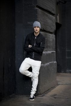 Marcel Floruss of One Dapper Street in a black jacket & t-shirt, white jeans, and beanie from our Modern Essentials Selected By Beckham collection by H&M OOTD