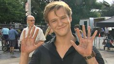 ET dropped by the Atlanta set to chat with Lucas Till and his stunt double, Mike Wilson.