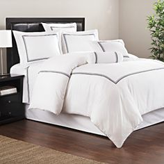 @Overstock - This Admiralty Baratto Duvet Cover Set by Roxbury Park is constructed of a white, 300 thread count sateen cotton. This duvet cover set features three navy slate and platinum 2 cm stripes at the sides and foot of the bed.http://www.overstock.com/Bedding-Bath/Roxbury-Park-Admiralty-Stripe-Baratto-Duvet-Cover-Set/6839734/product.html?CID=214117 $144.99