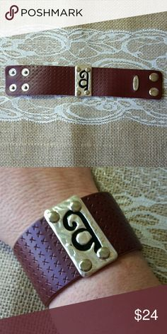 PLUNDER DESIGN NONA CUFF Lovely textured leather cuffs with beautiful monograms. This one is in stock. If you would like a different initial, just let me know. I am a Plunder Design Distributor. All of my products carry the Plunder Design warranty. Hypoallergenic, Lead & Nickel-Free. Plunder Design  Jewelry Bracelets