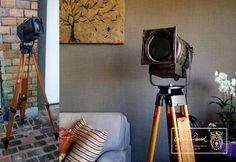 LUMINARIA - Antique refurbished theatrical Spot light on a beautiful reconditioned thedolite tripod.