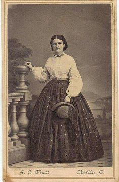 White waist with belt and skirt.
