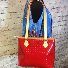 NWOT ARCADIA RED PATENT LEATHER SHOPPER TOTE This is a nice roomy bag with several sections to help to keep you organized. Made in Italy. Inner zip pockets. Bright red patent leather with tan vachetta leather trim. Gold tone brass fittings. Brass protective feet on the bottom of the bag. Patent leather in excellent condition. Arcadia Bags Totes