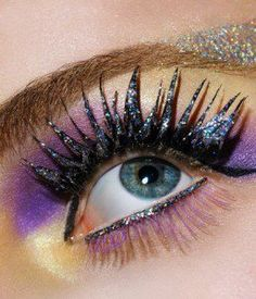 purple and yellow eyeshadow with glitter mascara for blue eyes