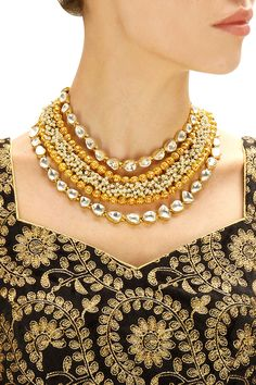 Gold finish filigree beads and baby pearl necklace available by Rohita and Deepa. Shop now: www.perniaspopups.... #necklace #charming #designer #rohitaanddeepa #pretty #accessory #shopnow #perniaspopupshop #happyshopping